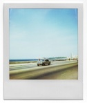 Polaroid of a car on a motorway
