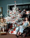Women sat by Christmas tree