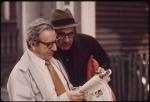 Men reading the paper
