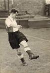 Watty Moore, footballer, kicking a ball