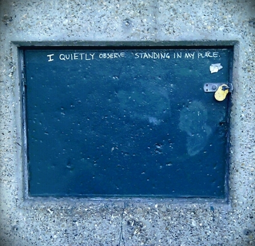 "Graffito: ""I quietly observe, standing in my place"""