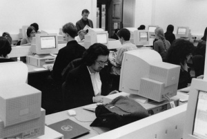 People working away in a computer suite