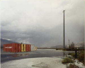 Containers in bleak landscape