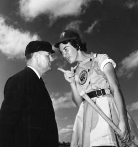 Woman baseball player arguing with umpire