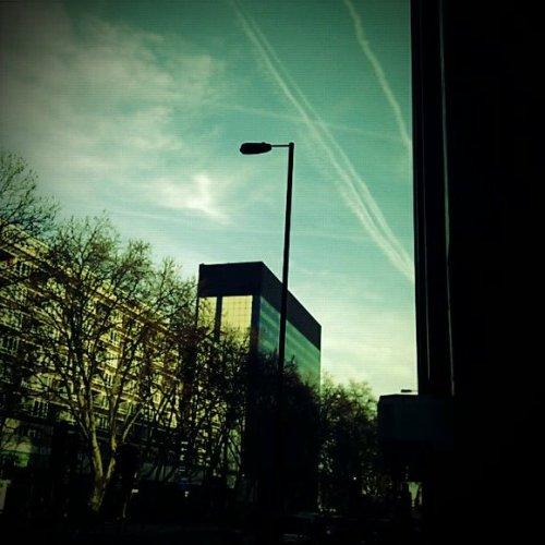 Sky, tall building, street lamp