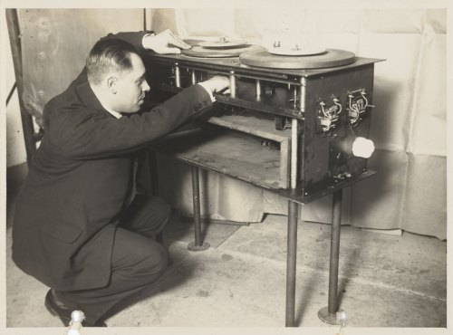 Man playing around with some crazy old record player