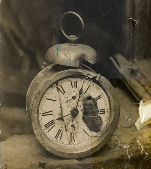 Beaten-up photo of a beaten-up alarm clock