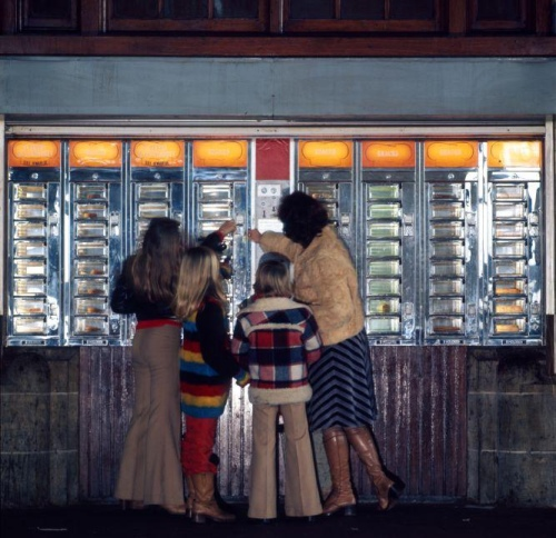A family gathered around a series of vending machines