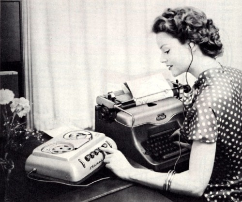 woman at desk with typewriter
