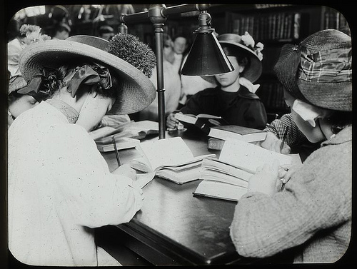 Women reading at a desk