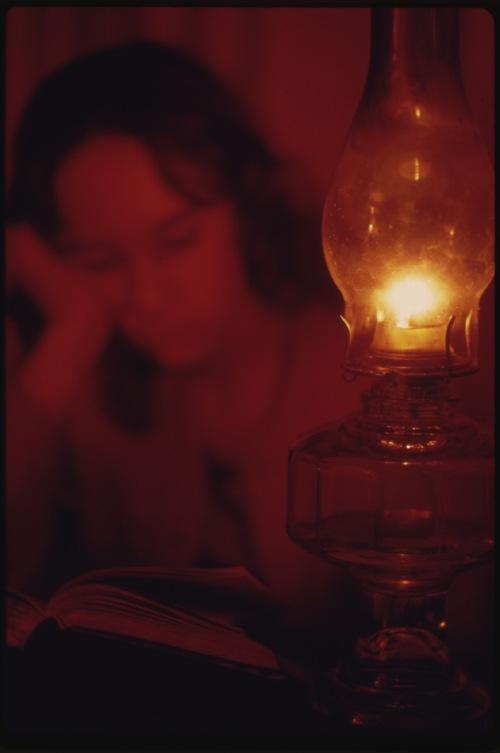 Woman eading by gaslight