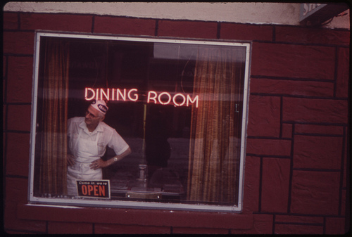 Man looking out of diner window