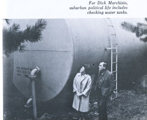 Man and woman checking water tank