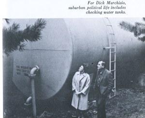 Man and woman checking water tank
