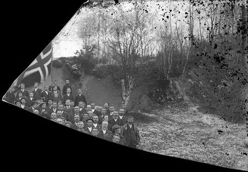 fragmented photo of men with flag