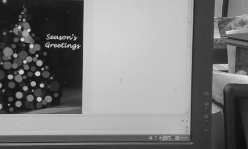 Monitor displaying Christmas card email