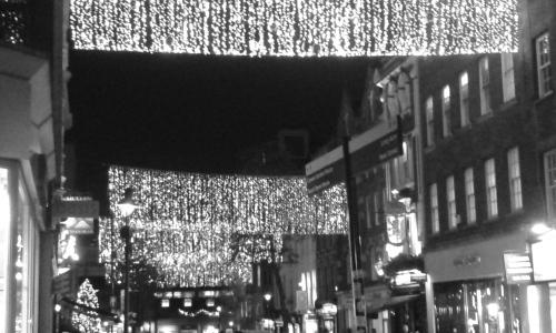 Christmas lights strung across street