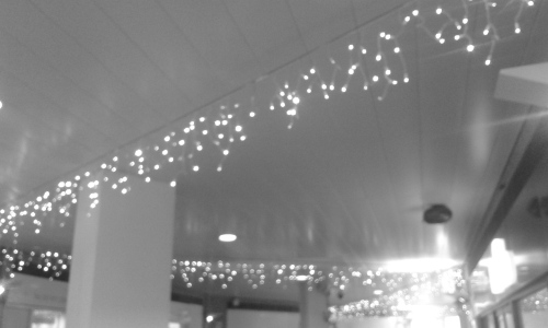 blurry christmas lights in a shopping centre