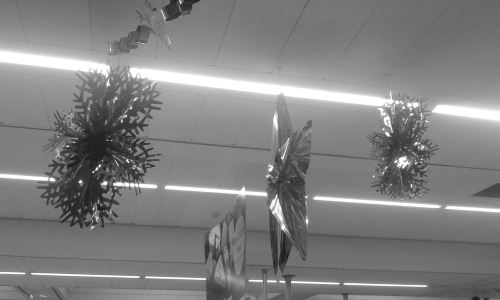 Christmas decorations hanging from supermarket ceiling