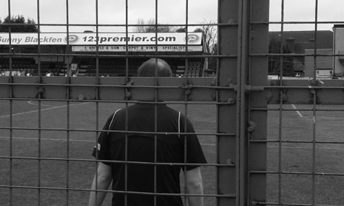 Assistant referee through a cage
